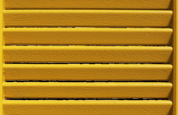 yellow wood coating on blinds